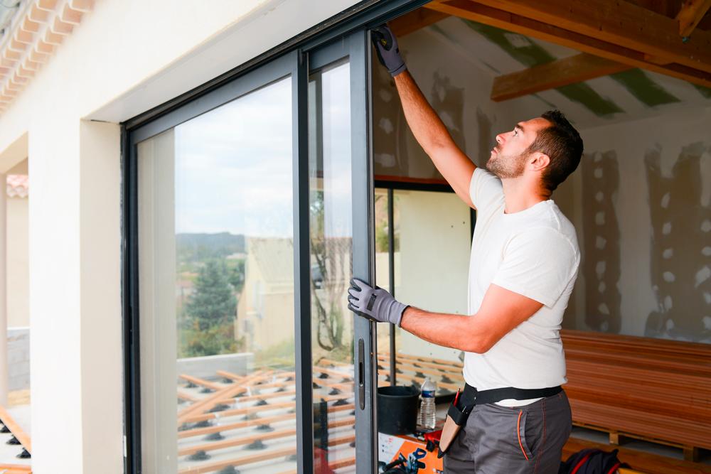 man installing hurriSignature Impact Windows